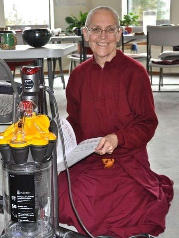 Venerable Semkye is all smiles as she unpacks a brand new HEPA vacuum cleaner offered by a generous supporter in Singapore.