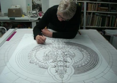 A snapshot of Bev working on the details of the Chenrezig window drawing