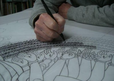 Close up of Bev's hand as she works on the drawing of the Chenrezig window drawing