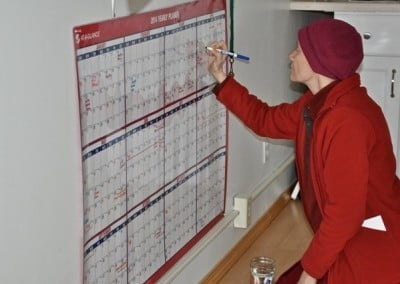 Venerable Thubten Samten keeps track of the calendar of events that will begin at the end of winter retreat.