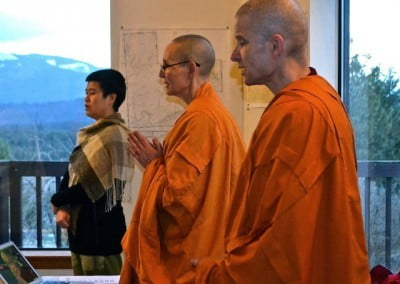 To keep our minds in the Dharma we chant the Buddha's mantra while waiting for teachings to begin.
