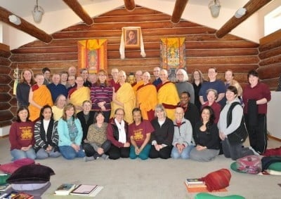 A group photo of Venerable Chodron with buddhist nuns and retreatants.