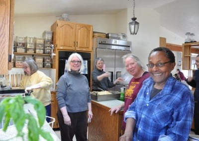 A group of people working inside Abbey kitchen.