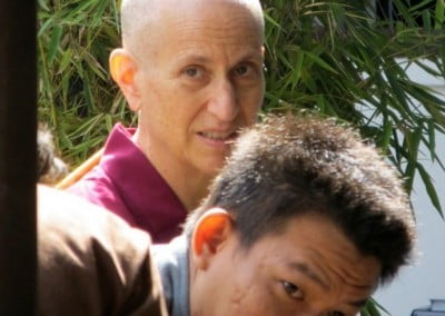 Hendra deftly translates Ven. Chodron's talks into Bahasa Indonesia.