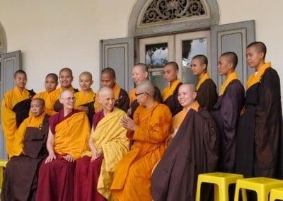 Venerable Chodron smiling happily with the bhikshuni sangha.