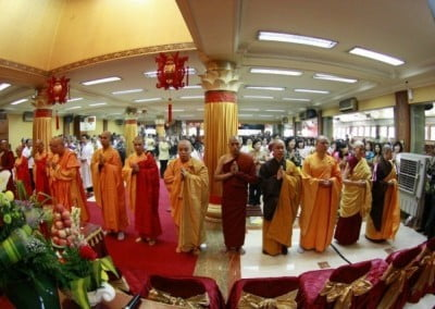 Monastics of three Buddhist traditions and Venerable Chodron lining in a row in a big hall with many others in Jakarta.