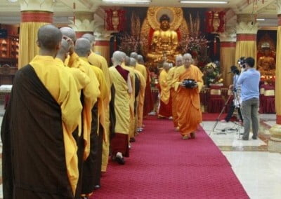 The abbot leads the sangha in an alms walk.