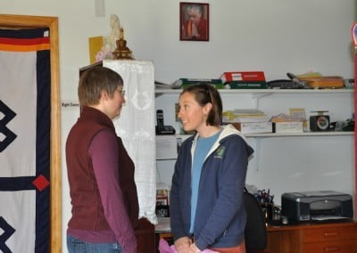 Two women talking to each other in the office in Ananda