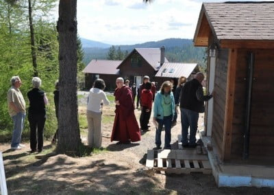 A group of people talking and standing outside the Meditation Hall