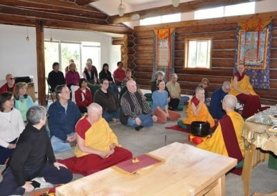 Venerable Semkye giving a Dharma talk to a group of people and some buddhist nuns and a anagarika.