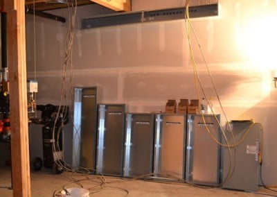 Electric service panels that will house all the fuses for the electrical needs  of <br> the hall line up on the wall.