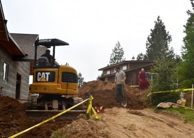 The going is slow in order not to damage the existing  underground water and power lines.