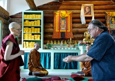 Roger offers a special amulet of the Thai forest tradition to Venerable Thubten Tarpa, who receives it for the community.