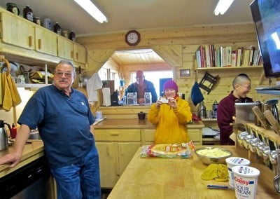 Roger, the hermitage owner-manager, shows Venerables Thubten Samten and Damcho the new kitchen where he cooks for the sangha.