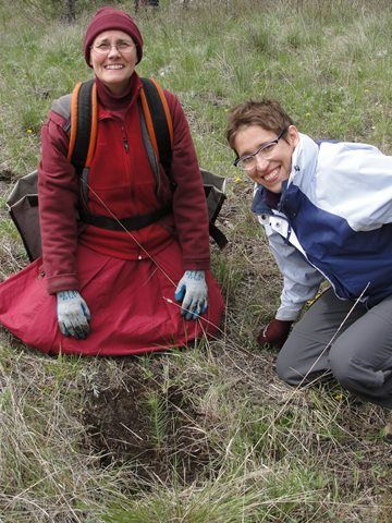 Venerable Thubten Chonyi with her helper, Rachel, who dug all the holes.
