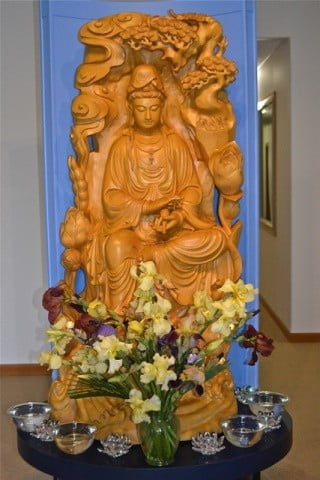 Kuan Yin and a glorious flower offering.