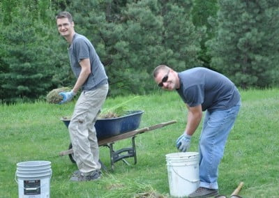 Chris and Jim plant grass for erosion control.