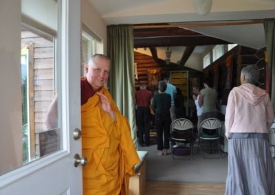 Venerable Thubten Tsultrim waits for Venerable Thubten Chodron to arrive.