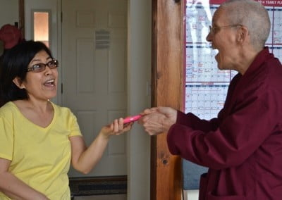 Pat playfully turns over her iPhone to Venerable Thubten Semkye.