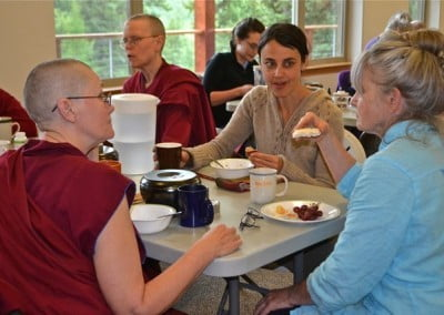 Venerable Thubten Chonyi visits with Mary Grace and Ann during the lunch break.