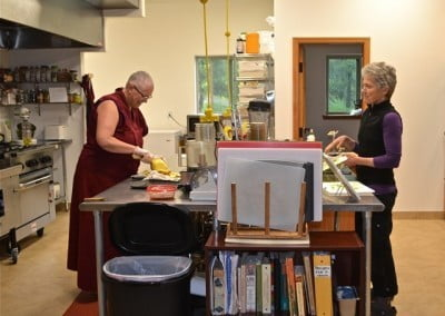 Venerable Thubten Yeshe and Sarah make a wonderful team feeding 35 people.