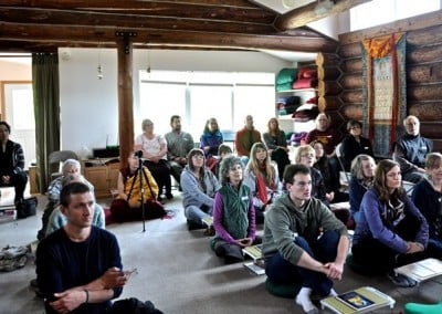 The group is attentive and focused on the Dharma.