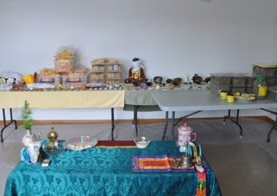 The room before Venerable Thubten Chodron did a puja to consecrate all the materials—mantra rolls, incense, sacred objects, and so forth—to fill the 22 statues.