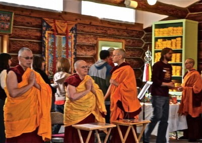 The sangha chant the Buddha's name as guests make their offerings.