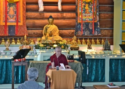Venerable Samten leads the session in the meditation hall