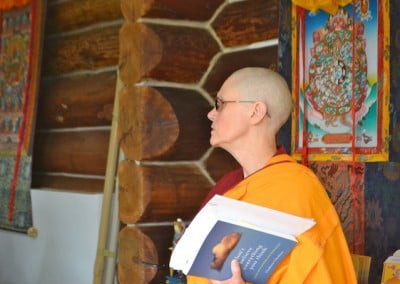 Venerable Chonyi waits to give the talk from Venerable Chodron's book, Don't Believe Everything You Think.