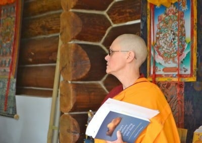 Venerable Chonyi holds a book.