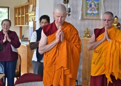 Venerables Losang and Yeshe chant while waiting for Venerable Chodron to arrive.