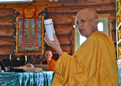 Venerable Chodron holds a thermos while teaching.