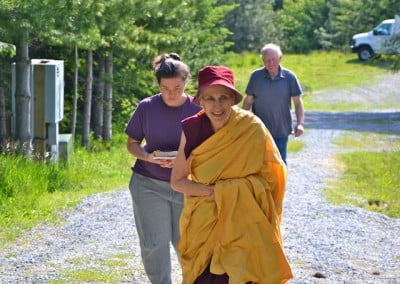 Venerable and students walk up a path.
