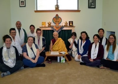 Venerable Chodron and many students smile at the camera