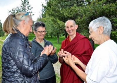 Venerable Tsepal gives a demonstration of the mandala offering hand mudra.