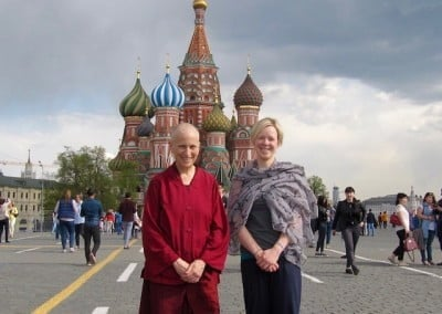 Venerable Chodron and her attendant, Caz in front of St. Basil's cathedral.
