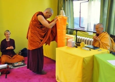 A monk offers the mandala before Venerable Chodron.
