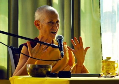 A Buddhist nun in front of a microphone