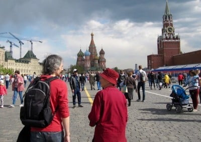 A man and women with backs to the camera in front of St. Basil's cathedral