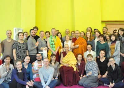 A group picture of Buddhist monks, a nun, and lay students.
