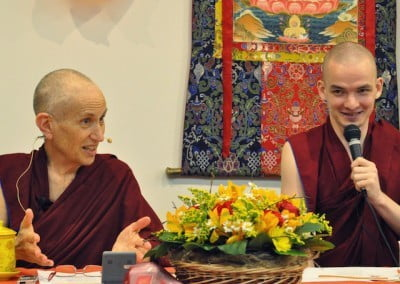 A nun teaching and a monk translating