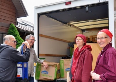 Volunteers and monastics wait to unload the truck.