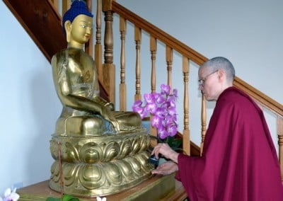 Venerable Tarpa cleaning the statue.