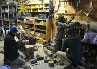 Brian, Clinton, and James fill the woodbins in the workshop for winter.