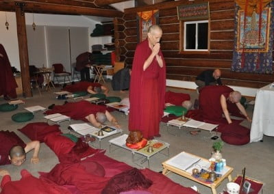 Venerable Thubten Chodron leads the prostrations.
