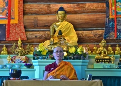 The Buddha looks on as Venerable Thubten Chonyi explains the Dharma.