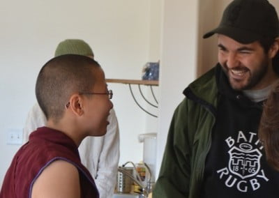 Venerable Thubten Damcho meets a first-time guest who is from Brazil.