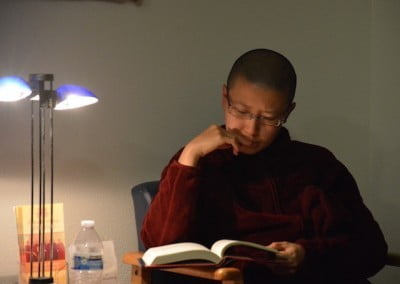 Ven. Damcho takes advantage of quiet time between teachings.