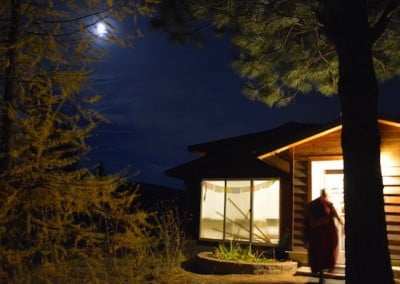 A full moon over the Meditation Hall, all lit up for evening practice.